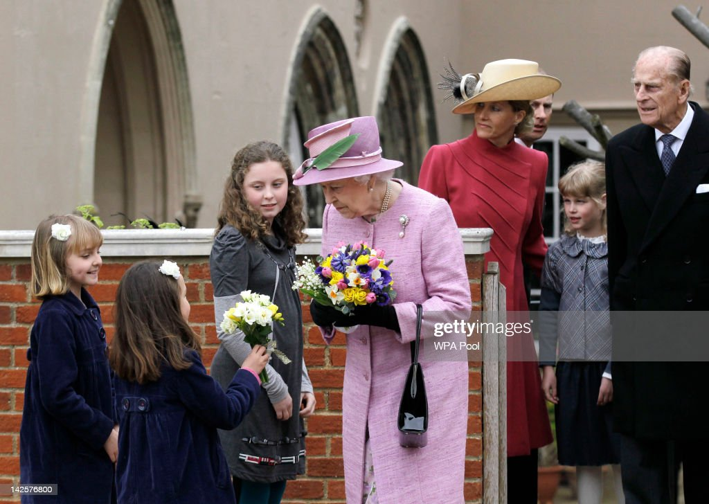 Queen Elizabeth II receives flowers from young well wishers while her husband Prince Philip Duke of Edinburgh daughterinlaw Sophie Countess of Wessex...