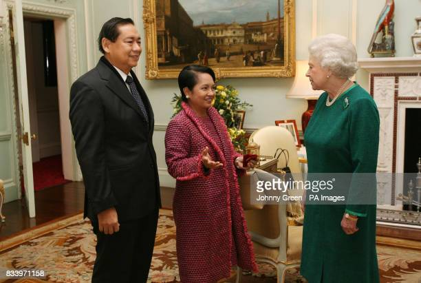 Queen Elizabeth II receives Her Excellency the President of the Phillipines Gloria MacapagalArroyo and her husband Jose Miguel Arroyo inside...