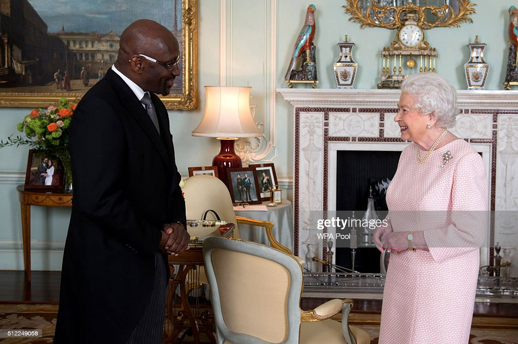 Queen Elizabeth II receives His Excellency Mr Karl Hood on his appointment as High Commissioner for Grenada at Buckingham Palace on February 25, 2016 in Walton-on-Thames, England.