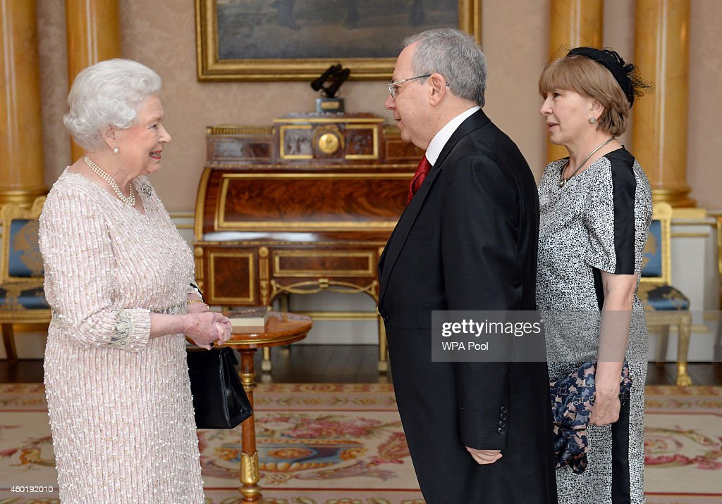 Queen Elizabeth II receives The Ambassador of Georgia Dr Revaz Gachechiladze and Mrs Mzia Marsagishvili as he presents his Letter of Credence at Buckingham Palace on December 9, 2014 in London, England.