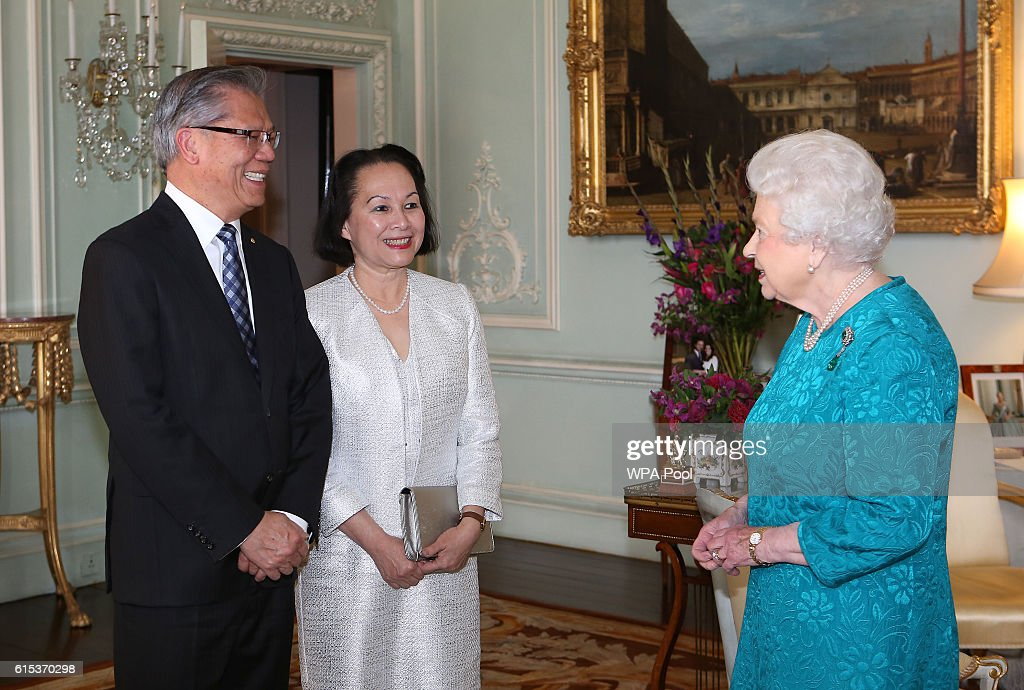 Queen Elizabeth II receives the Governor of South Australia, the Hon. Hieu Van Le and his wife Mrs Le at Buckingham Palace on October 18, 2016 in London, England.