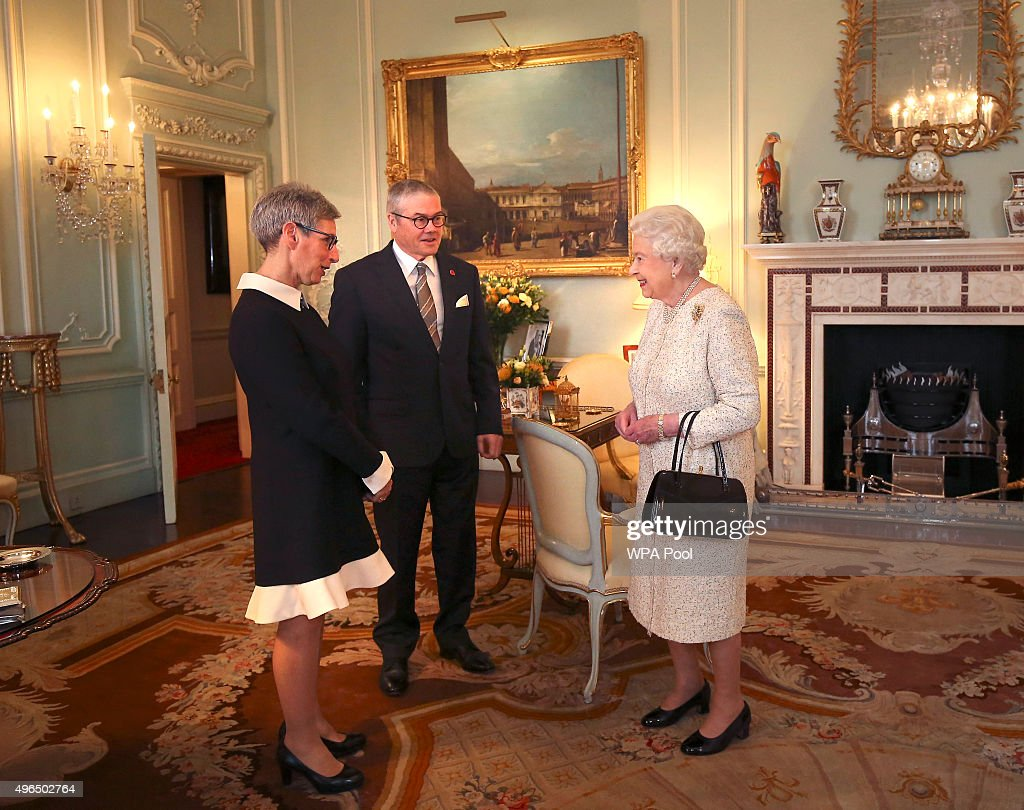 Queen Elizabeth II receives the Governor of Victoria, the Hon Linda Dessau AM and her husband Judge Anthony Howard during an audience at Buckingham Palace on November 10, 2015 in London, England.