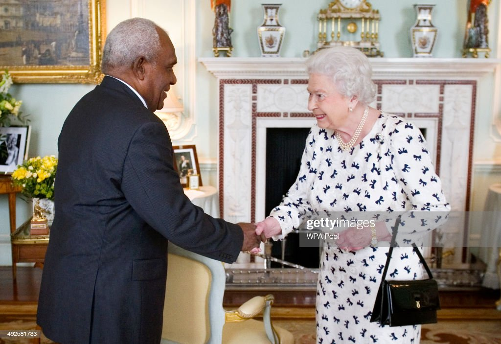 Queen Elizabeth II receives the Governor-General of the Solomon Islands Sir Frank Utu Ofagioro Kabui at Buckingham Palace on May 21, 2014 in London, United Kingdom.