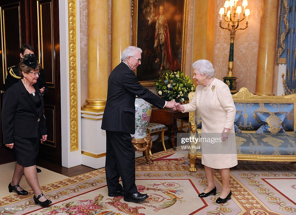 Queen <a gi-track='captionPersonalityLinkClicked' href=/galleries/search?phrase=Elizabeth+II&family=editorial&specificpeople=67226 ng-click='$event.stopPropagation()'>Elizabeth II</a> receives the newly appointed Lieutenant Governor the Hon. Frank Lewis for Prince Edward Island, and wife Mrs Lewis at Buckingham Palace on February 26, 2013 in London, England.