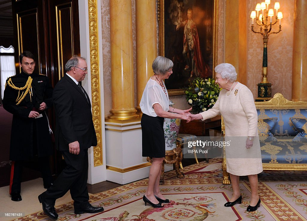 Queen <a gi-track='captionPersonalityLinkClicked' href=/galleries/search?phrase=Elizabeth+II&family=editorial&specificpeople=67226 ng-click='$event.stopPropagation()'>Elizabeth II</a> receives the newly appointed Lieutenant Governor the Hon. Judith Guichon for British Columbia and Mr Bruno Mailloux at Buckingham Palace on February 26, 2013 in London, England.