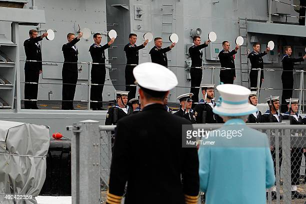Queen Elizabeth II receives 'three cheers for Her Majesty' from the ship's company of HMS Lancaster at Portsmouth Naval Base after a visit to the...
