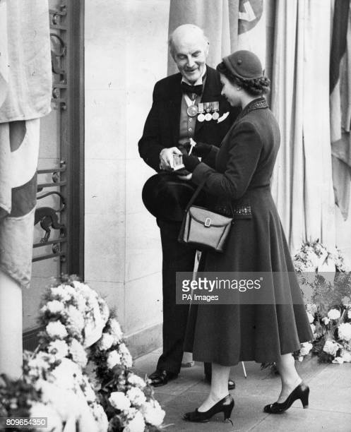 Queen Elizabeth II receiving a silver key with which to unlock the entrance door of the Runnymede Memorial from the architect Edward Maufe The...