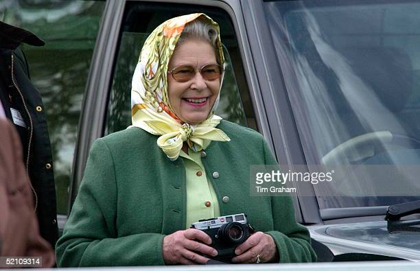 Queen Elizabeth II Relaxed And Laughing In Casual Clothes And A Headscarf She Is Watching Her Husband Taking Part In The International Driving Grand...