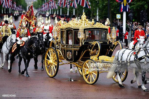 Queen Elizabeth II returns to Buckingham Palace in the new Diamond Jubilee state coach following the State Opening of Parliament on June 4 2014 in...