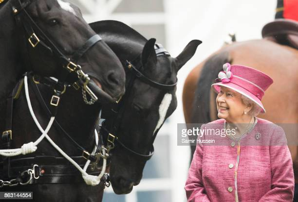Queen Elizabeth II reviews The King's Troop Royal Horse Artillery on the 70th anniversary at Hyde Park on October 19 2017 in London England The KTRHA...