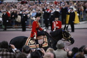 Queen Elizabeth II riding a horse in ceremonial dress during the Trooping the Colour ceremony on Horse Guards Parade London England Great Britain...