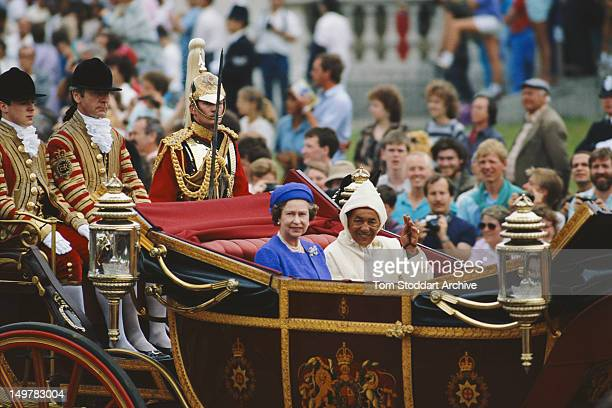 Queen Elizabeth II riding in a coach with Hassan II of Morocco during a state visit London July 1987