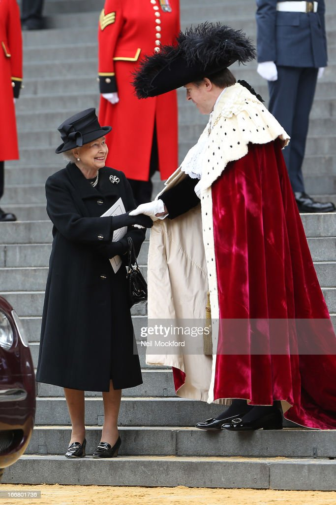 Queen <a gi-track='captionPersonalityLinkClicked' href=/galleries/search?phrase=Elizabeth+II&family=editorial&specificpeople=67226 ng-click='$event.stopPropagation()'>Elizabeth II</a> seen attending Baroness Thatcher's Funeral at St Paul's Cathedral on April 17, 2013 in London, England.