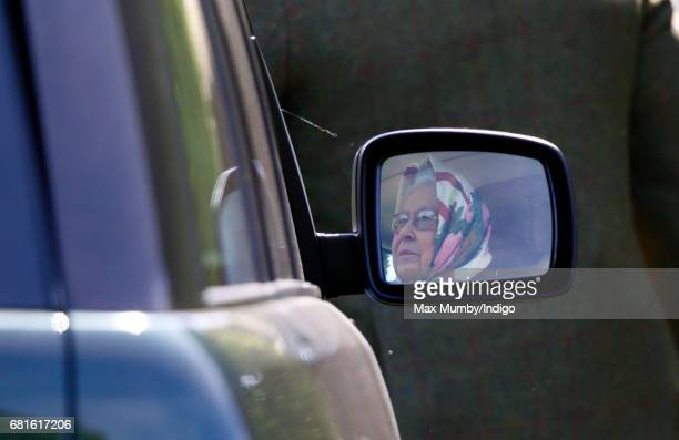 Queen Elizabeth II seen reflected in the wing mirror of her Range Rover car as she drives herself around on day 1 of the Royal Windsor Horse Show in...