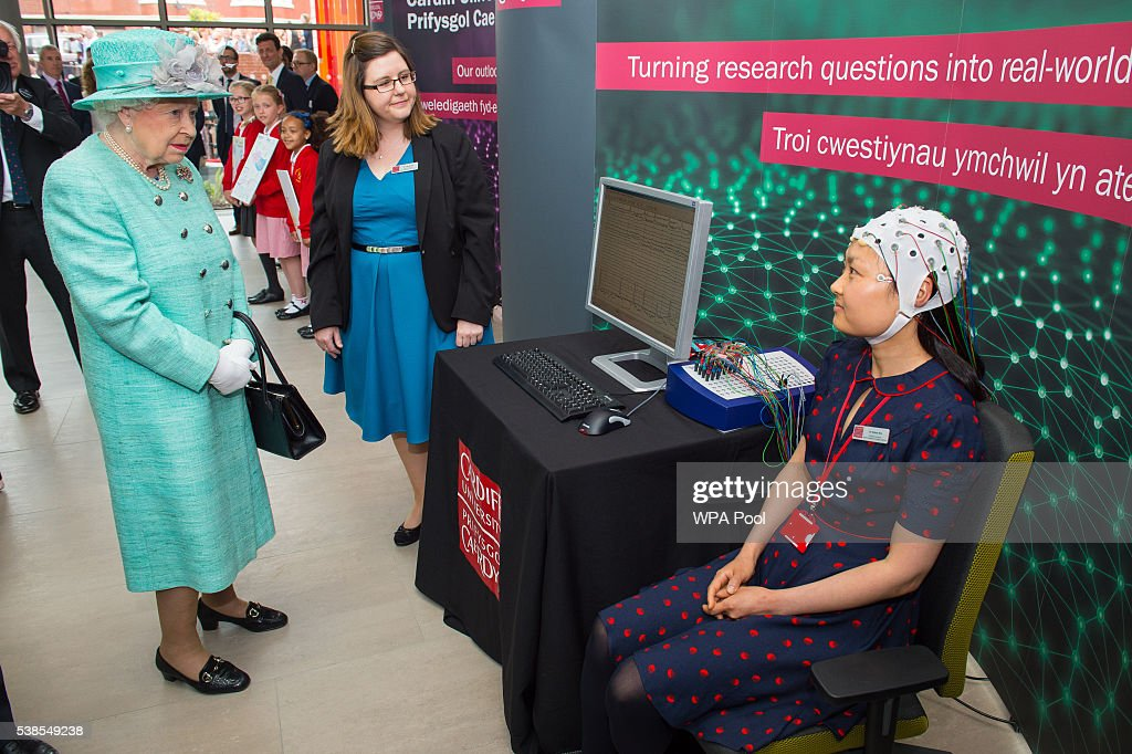 Queen Elizabeth II sees a brain activity scan demonstrated by Dr Grace Xia as she opens the Cardiff University Brain Research Imaging Centre on June 7, 2016 in Cardiff, Wales.