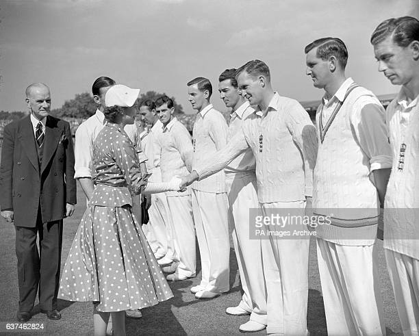HRH Queen Elizabeth II shakes hand with England's Jim Laker as England captain Len Hutton introduces his team before the start of the day's play
