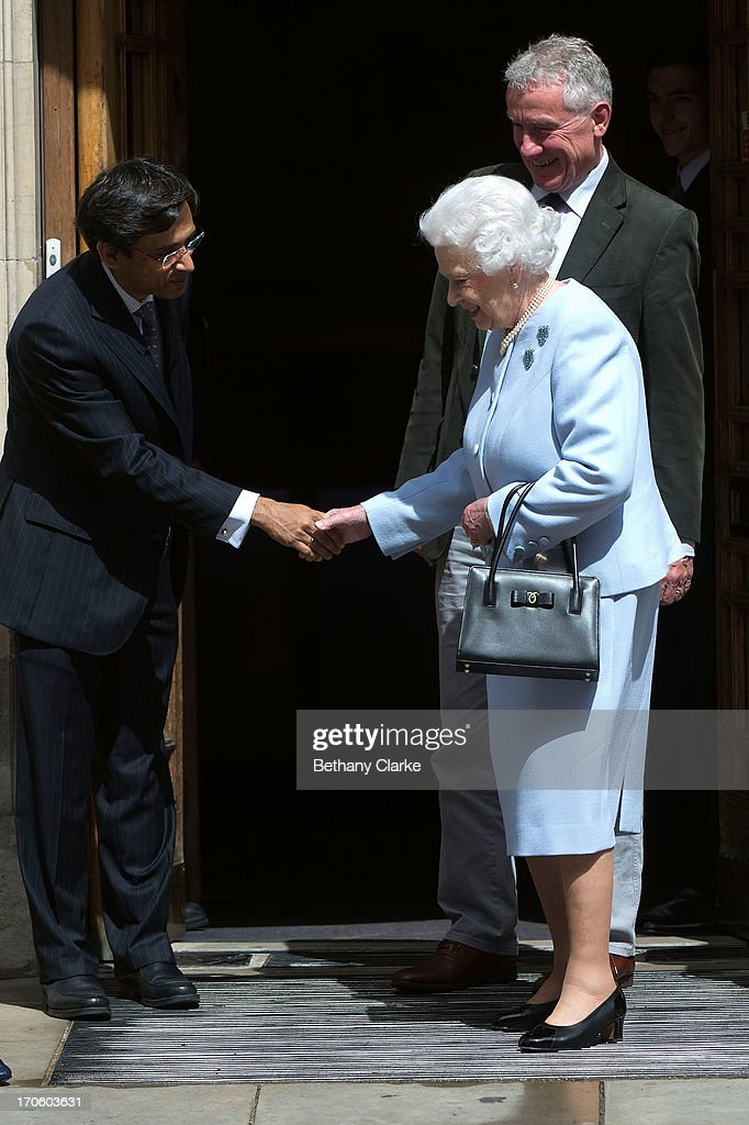 Queen <a gi-track='captionPersonalityLinkClicked' href=/galleries/search?phrase=Elizabeth+II&family=editorial&specificpeople=67226 ng-click='$event.stopPropagation()'>Elizabeth II</a> shakes hands with a member of staff as she leaves the London Clinic after visiting her husband Prince Philip, Duke of Edinburgh on June 15, 2013 in London, England. The Duke of Edinburgh is recovering in hospital after undergoing exploratory abdominal surgery.