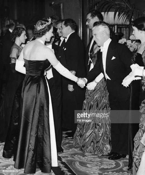 Queen Elizabeth II shakes hands with actor Charles Chaplin during meeting in Empire Theatre London for the Royal Film Performance a benefit...