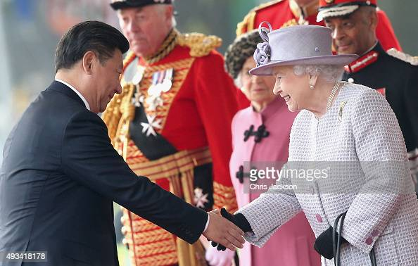 Queen Elizabeth II shakes hands with Chinese President Xi Jinping on Horseguards Parade during the Official Ceremonial Welcome for the Chinese State...