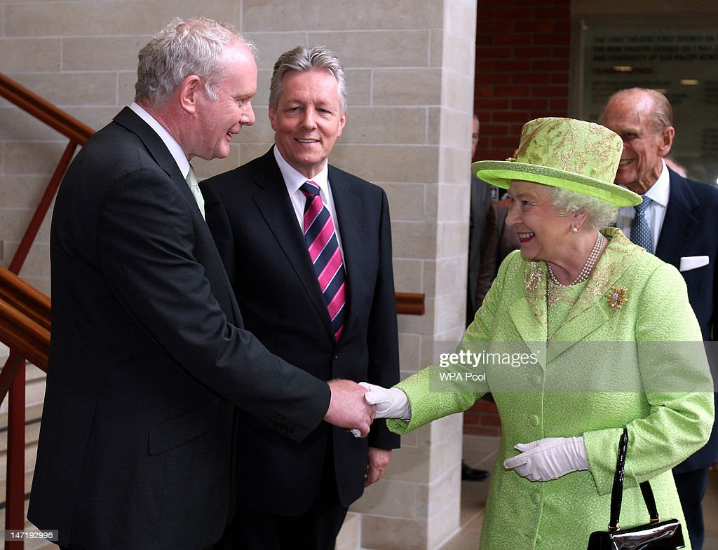 Queen <a gi-track='captionPersonalityLinkClicked' href=/galleries/search?phrase=Elizabeth+II&family=editorial&specificpeople=67226 ng-click='$event.stopPropagation()'>Elizabeth II</a> shakes hands with Deputy First Minister of Northern Ireland <a gi-track='captionPersonalityLinkClicked' href=/galleries/search?phrase=Martin+McGuinness&family=editorial&specificpeople=211317 ng-click='$event.stopPropagation()'>Martin McGuinness</a> watched by First Minister Peter Robinson (C) at the Lyric Theatre on June 27, 2012 in Belfast, Northern Ireland. During the Queen's two day visit to Northern Ireland she held a hugely significant meeting with former IRA commander and deputy First Minister of Northern Ireland, <a gi-track='captionPersonalityLinkClicked' href=/galleries/search?phrase=Martin+McGuinness&family=editorial&specificpeople=211317 ng-click='$event.stopPropagation()'>Martin McGuinness</a> at the Lyric Theatre today. The Queen will also visit the newly opened Titanic Museum and the town of Enniskillen.