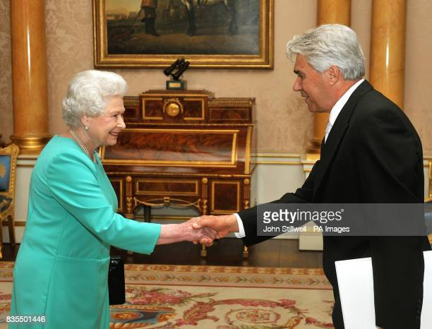 Queen Elizabeth II shakes hands with Dr Ivica Tomic the Ambassador of Croatia before he presents his Credentials during a private audience with Her...