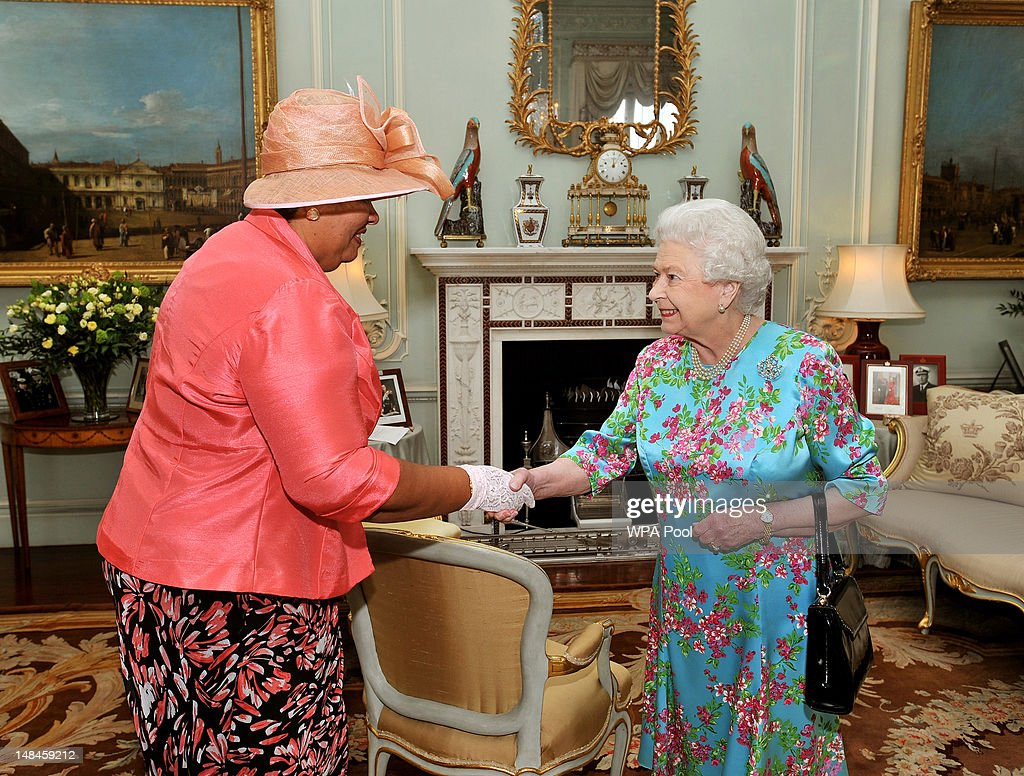 Queen <a gi-track='captionPersonalityLinkClicked' href=/galleries/search?phrase=Elizabeth+II&family=editorial&specificpeople=67226 ng-click='$event.stopPropagation()'>Elizabeth II</a> (R) shakes hands with Mrs Aloun Ndombet-Assamba, the High Commissioner for Jamaica, during a private audience at Buckingham Palace on July 17, 2012 in central London, England.