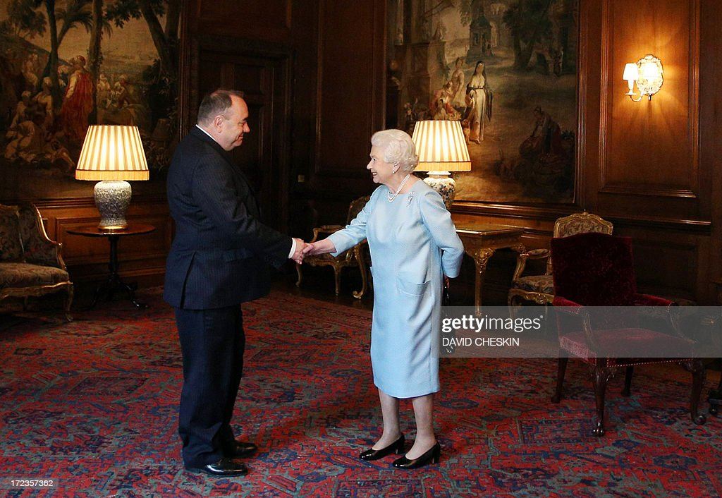 Queen Elizabeth II shakes hands with Scottish First minister Alex Salmond (L) during an audience at the Palace of Holyrood House in Edinburgh on July 2, 2013. AFP PHOTO/POOL/ David Cheskin