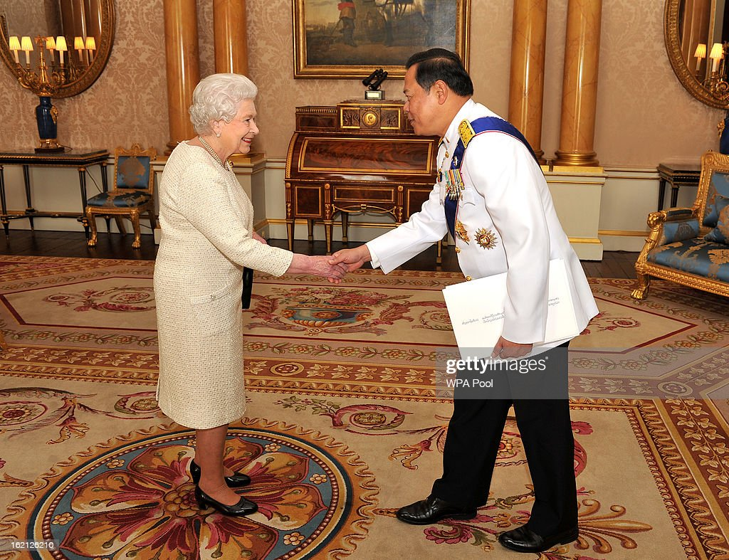 Queen Elizabeth II shakes hands with the Ambassador of the Thailand Mr Pasan Teparak, during a private audience presenting his Credentials at Buckingham Palace on February 19, 2013 in London, England.