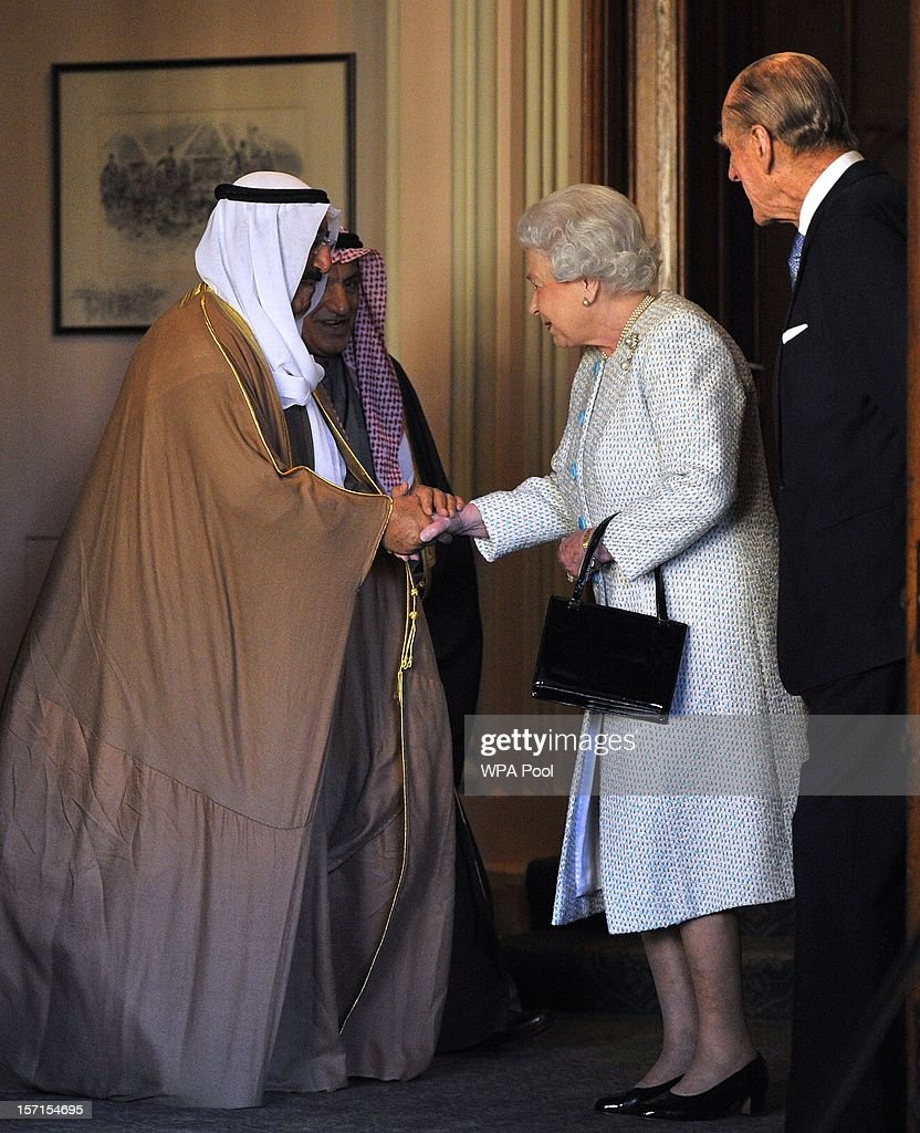 Queen <a gi-track='captionPersonalityLinkClicked' href=/galleries/search?phrase=Elizabeth+II&family=editorial&specificpeople=67226 ng-click='$event.stopPropagation()'>Elizabeth II</a> shakes hands with the Amir of the State of Kuwait on his departure from Windsor Castle on November 29, 2012 in Windsor, England. The Amir has been on a three day State visit to the United Kingdom.