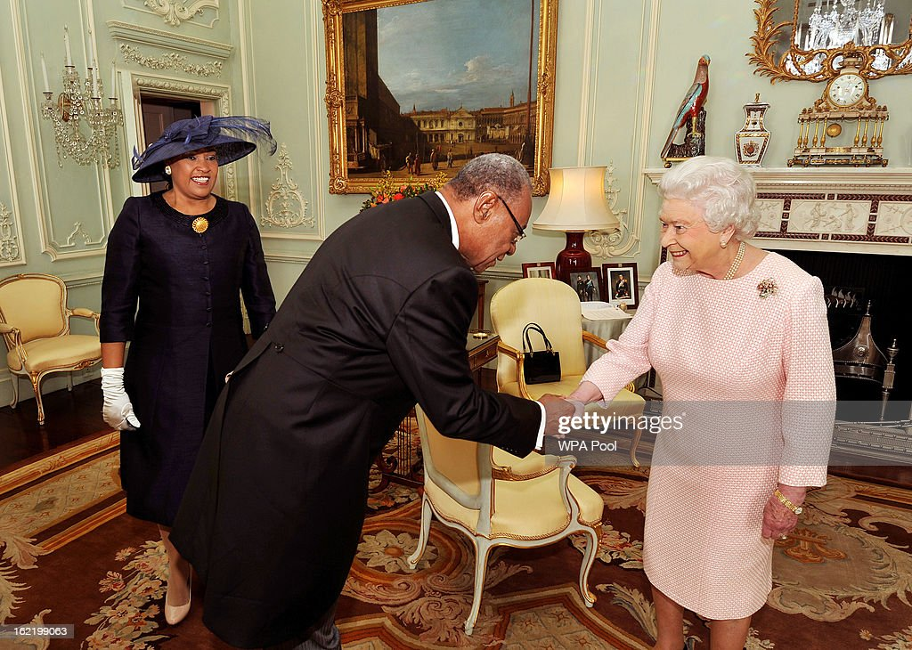Queen <a gi-track='captionPersonalityLinkClicked' href=/galleries/search?phrase=Elizabeth+II&family=editorial&specificpeople=67226 ng-click='$event.stopPropagation()'>Elizabeth II</a> shakes hands with the His Excellency the High Commissioner of the Bahamas Mr Eldred Bethel, as he and his wife Dawne were invited to a private audience with Her Majesty, at Buckingham Palace on February 20, 2012 in London, England.
