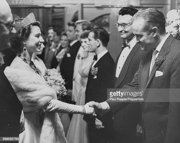 Queen Elizabeth II shaking hands with American entertainer Bob Hope after watching the Royal Variety Performance at the London Palladium November 1st...