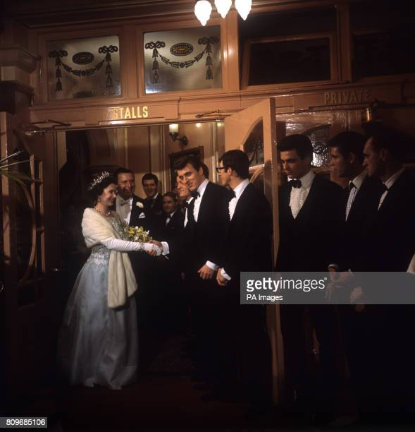 Queen Elizabeth II shaking hands with Bruce Welch of The Shadows before the Royal Variety Performance at the London Palladium