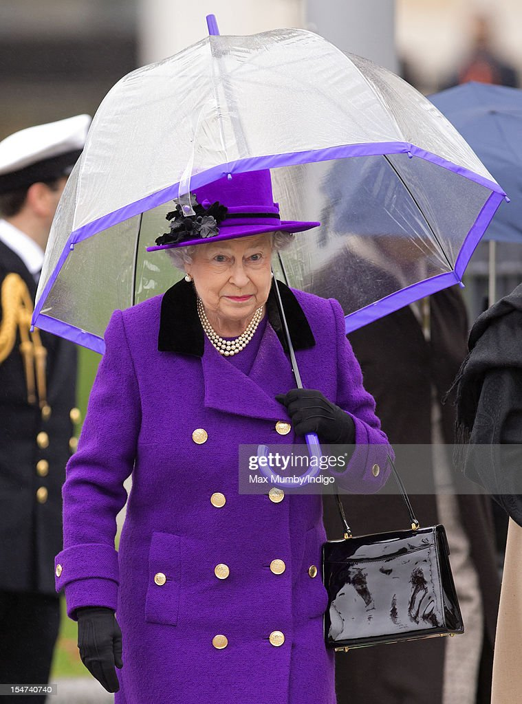 Queen <a gi-track='captionPersonalityLinkClicked' href=/galleries/search?phrase=Elizabeth+II&family=editorial&specificpeople=67226 ng-click='$event.stopPropagation()'>Elizabeth II</a> shelters under an umbrella as attends the opening of the newly developed Jubilee Gardens on October 25, 2012 in London, England.