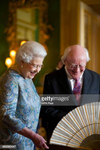 Queen Elizabeth II shows Irish President Michael D Higgins Irish related items from the Royal Collection in the Green Drawing Room at Windsor Castle...