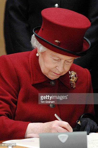 Queen Elizabeth II signing the official scroll to mark the opening of new Bradford Police Headquarters