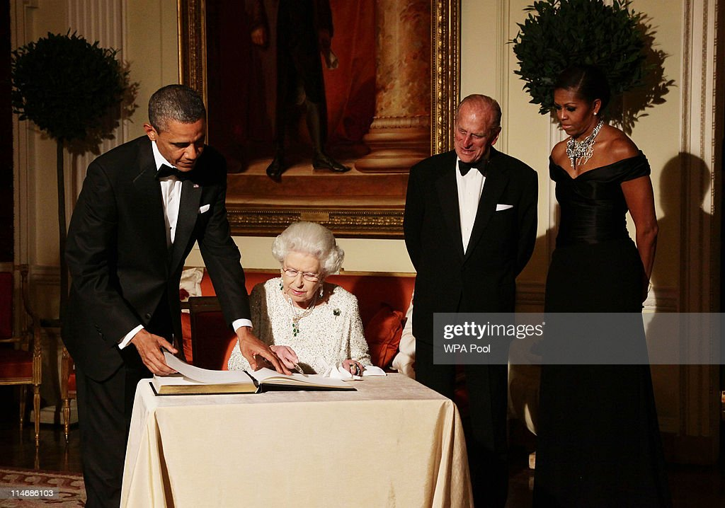 Queen Elizabeth II signs the guest book as she bids farewell to U.S. President Barack Obama (L) and First Lady Michelle Obama, watched by the Duke of Edinburgh (2nd R) at Winfield House - the residence of the Ambassador of the United States of America, in Regent's Park, on May 25, 2011 in London, England. The 44th President of the United States, Barack Obama, and First Lady Michelle are in the UK for a two day State Visit at the invitation of HM Queen Elizabeth II. Last night they attended a state banquet at Buckingham Palace and today's events include talks at Downing Street and the President will address both houses of Parliament at Westminster Hall.