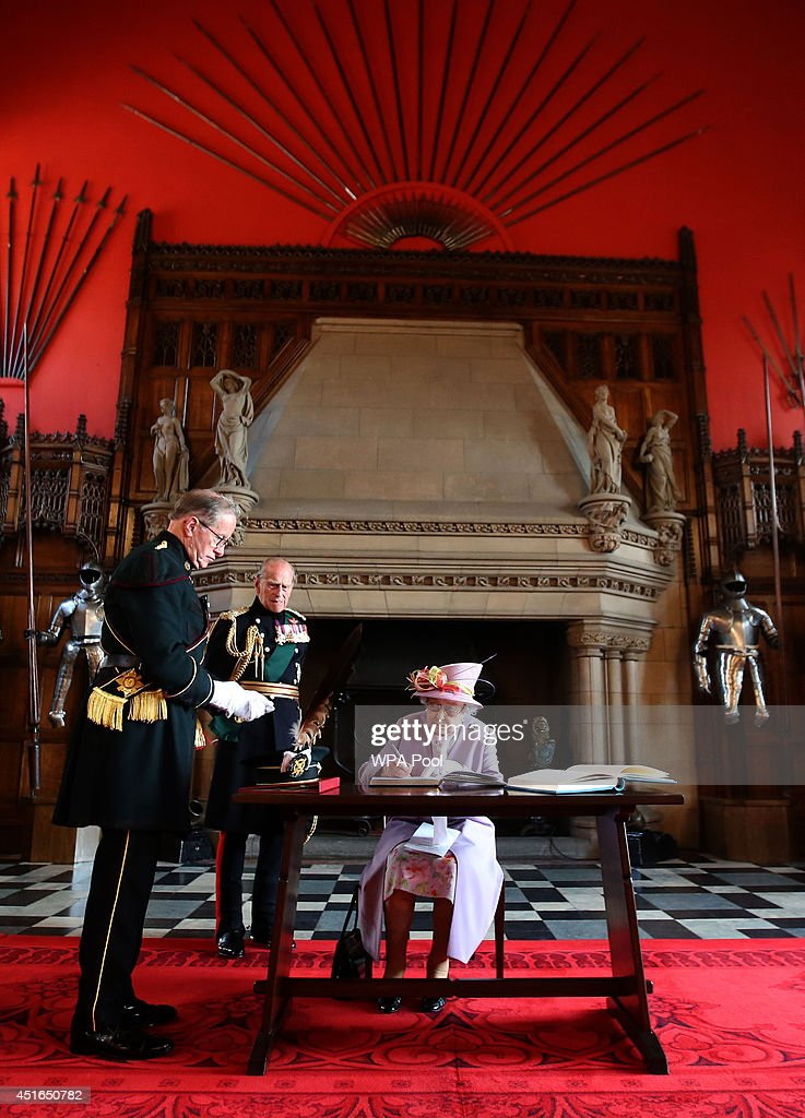 Queen <a gi-track='captionPersonalityLinkClicked' href=/galleries/search?phrase=Elizabeth+II&family=editorial&specificpeople=67226 ng-click='$event.stopPropagation()'>Elizabeth II</a> signs the guest book at the Great Hall at Edinburgh Castle after attending a commemorative service for the Scottish National War Memorial at Edinburgh Castle on July 3, 2014 in Edinburgh, Scotland.