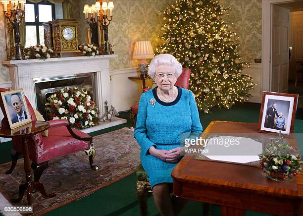 Queen Elizabeth II sits at a desk in the Regency Room after recording her Christmas Day broadcast to the Commonwealth at Buckingham Palace on...