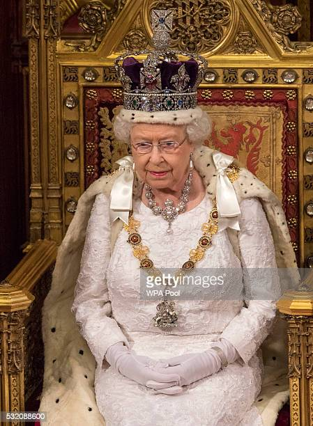 Queen Elizabeth II sits before delivering the Queen's Speech from the throne during State Opening of Parliament in the House of Lords at the Palace...