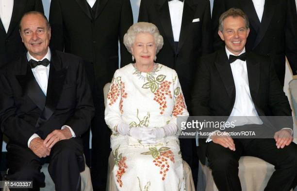 Queen Elizabeth II sits between French President Jacques Chirac and Britain's Prime Minister Tony Blair at Gleneagles Scotland Wednesday 6 July 2005...