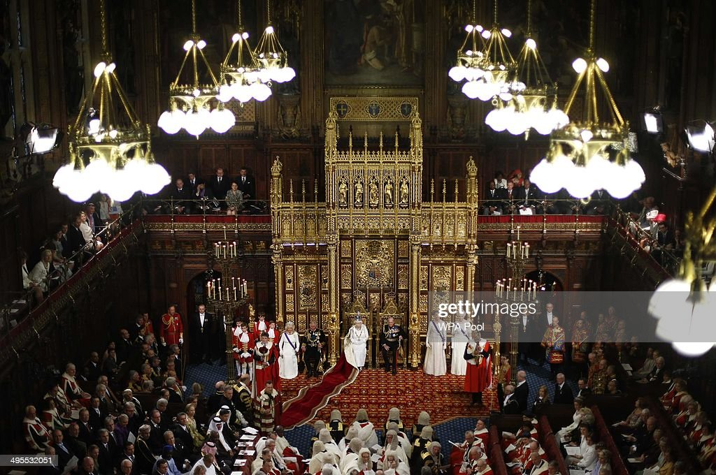 Queen Elizabeth II sits next to Prince Philip Duke of Edinburgh with Prince Charles Prince of Wales and Camilla Duchess of Cornwall as she delivers...
