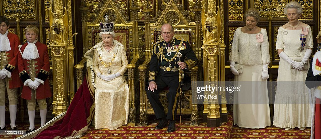 Queen Elizabeth II sits on the throne beside Prince Philip, Duke of Edinburgh in the House of Lords prior to delivering the Queen's Speech for the State Opening Of Parliament at the Palace of Westminster at the Palace of Westminster on May 25, 2010 in London, England. Queen Elizabeth II unveiled the new coalition government's legislative programme in a speech delivered to Members of Parliament and Peers in The House of Lords. Laws expected to be introduced in the coming Parliamentary year are thought to include new voting reforms, repeal of identity card legislation and new powers for parents to start their own schools.