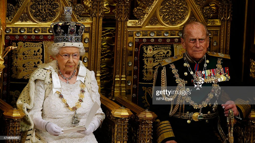 Queen Elizabeth II sitting next to Prince Philip Duke of Edinburgh looks up during the Queen's Speech in House of Lords at the Palace of Westminster...
