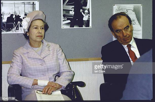 Queen Elizabeth II sitting with publisher K Rupert Murdoch at The Times monthly conference
