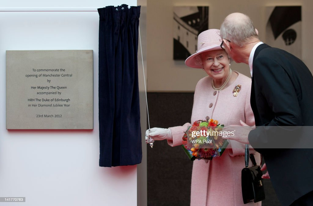 Queen <a gi-track='captionPersonalityLinkClicked' href=/galleries/search?phrase=Elizabeth+II&family=editorial&specificpeople=67226 ng-click='$event.stopPropagation()'>Elizabeth II</a> smiles after unveiling a plaque during her visit to the Manchester Central convention centre on March 23, 2012 in Greater Manchester, north-west England. The Queen and her husband, Prince Philip, the Duke of Edinburgh visited Manchester where she officially opened hospitals, toured the new BBC building at MetroCity and officially started a Sport Relief Mile fun run.