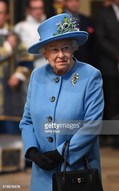 Queen Elizabeth II smiles as she arrives at the annual Commonwealth Day service on Commonwealth Day on March 14 2016 in Westminster Abbey London The...