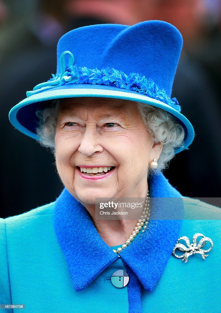 Queen Elizabeth II smiles as she arrives at Tweedbank Station on September 9, 2015 in Tweedbank, Scotland. Today, Her Majesty Queen Elizabeth II becomes the longest reigning monarch in British history overtaking her great-great grandmother Queen Victoria's record by one day. The Queen has reigned for a total of 63 years and 217 days. Accompanied by her husband, the Duke of Edinburgh and Scotland's First Minister Nicola Sturgeon, she will officially open the new Scottish Border's Railway which runs from the capital to Tweedbank.