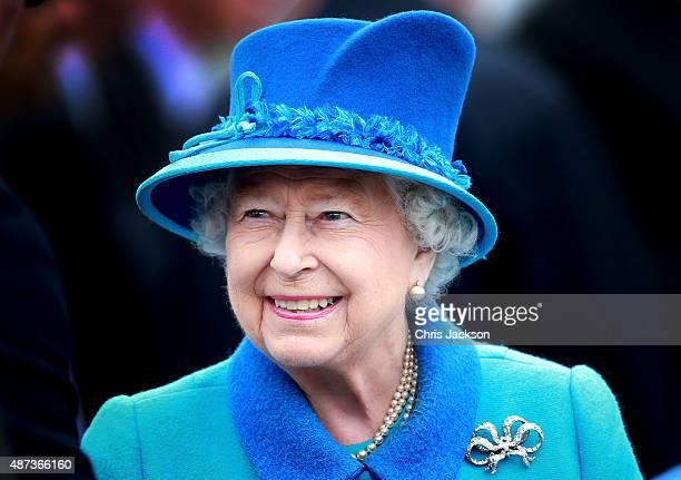 Queen Elizabeth II smiles as she arrives at Tweedbank Station on September 9 2015 in Tweedbank Scotland Today Her Majesty Queen Elizabeth II becomes...