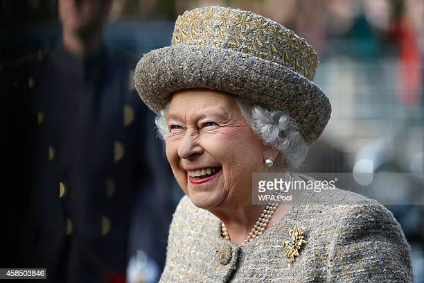 Queen Elizabeth II smiles as she arrives before the Opening of the Flanders' Fields Memorial Garden at Wellington Barracks on November 6 2014 in...