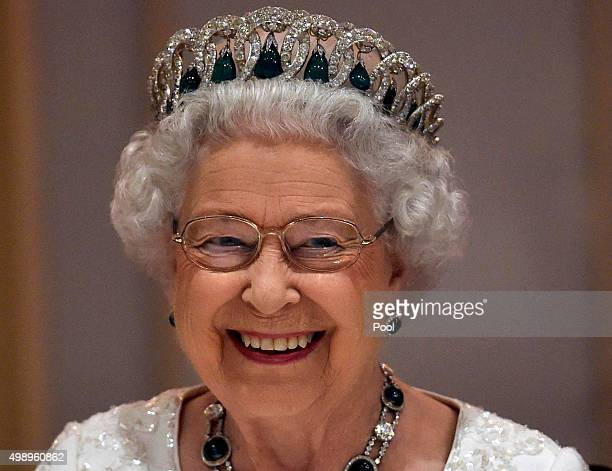 Queen Elizabeth II smiles as she attends a dinner at the Corinthia Palace Hotel in Attard during the Commonwealth Heads of Government Meeting on...